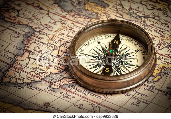 Old vintage compass on ancient map - csp9933826