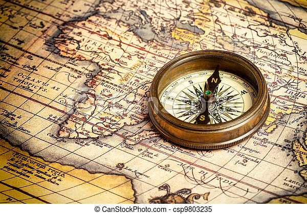 Old vintage compass on ancient map - csp9803235