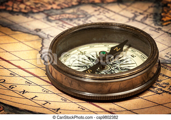 Old vintage compass on ancient map - csp9802382