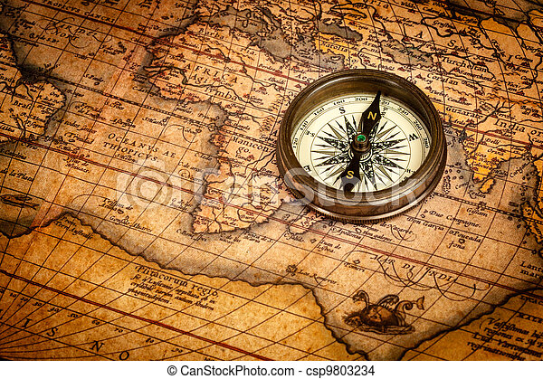 Old vintage compass on ancient map - csp9803234