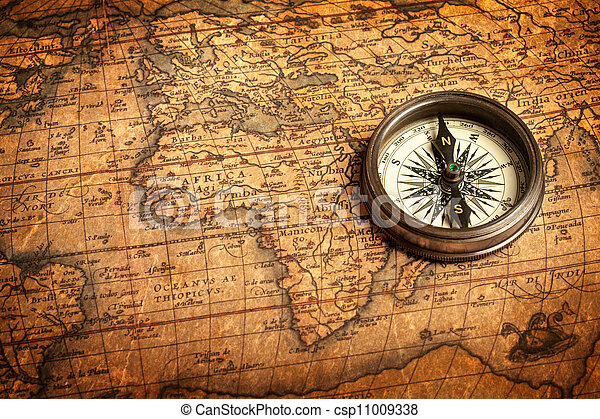 Old vintage compass on ancient map - csp11009338