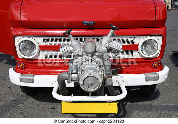 Old vintage fire truck with pumps and pipes - csp42234120