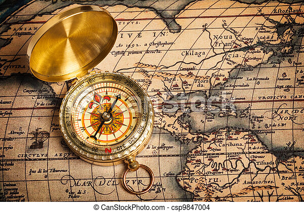 Old vintage golden compass on ancient map - csp9847004