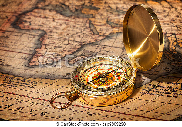 Old vintage golden compass on ancient map - csp9803230