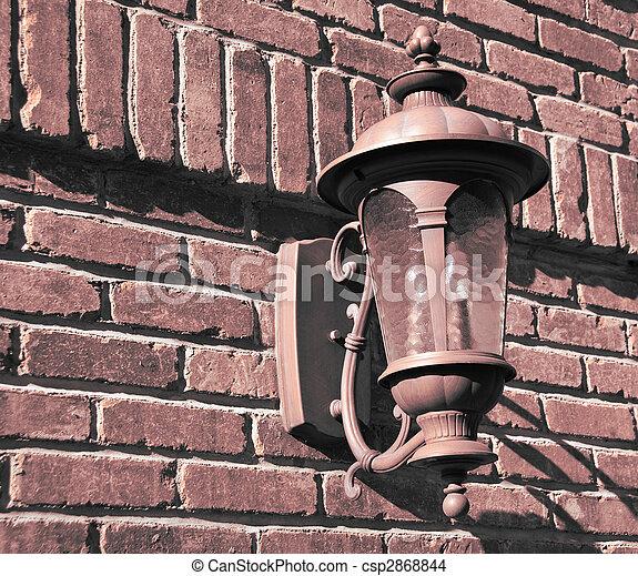 old vintage lamp on brick wall - csp2868844