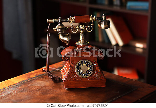 Old vintage retro telephone station. Great interior object. Old fashioned telephone. Vintage red phone. - csp70736391