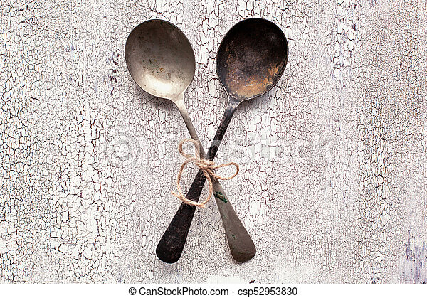 Old vintage spoons on white wooden background - csp52953830