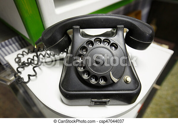 Old vintage telephone with rotary dial numbers - csp47044037