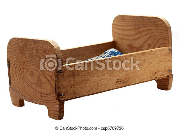 Old vintage woode doll's bed on white background - csp6709736