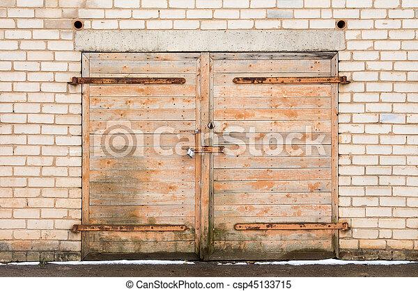 Old Weathered Wooden Garage Door Locked With Padlock