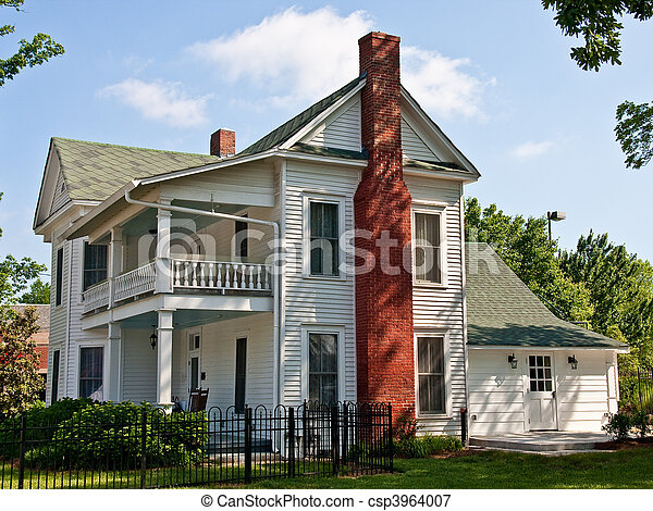 Old White Two Story Farmhouse With Red Brick Chimney Stock Photo