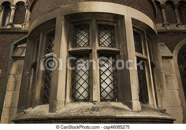 Old window on the brick wall of cathedral in Lviv - csp46085275