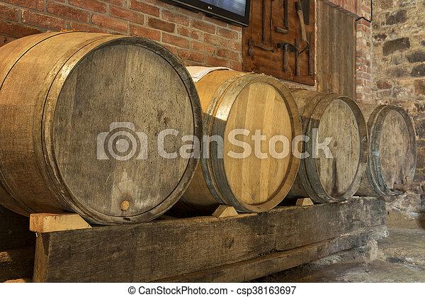 Old wine barrels in a cellar - csp38163697