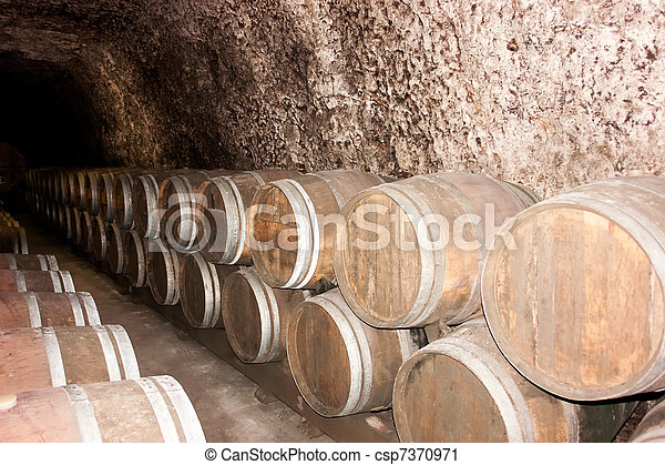 Old wine barrels in a wine cellar - csp7370971