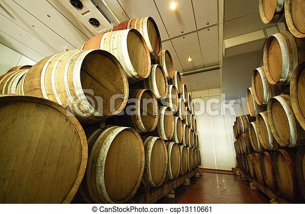 Old wine barrels in a wine cellar - csp13110661