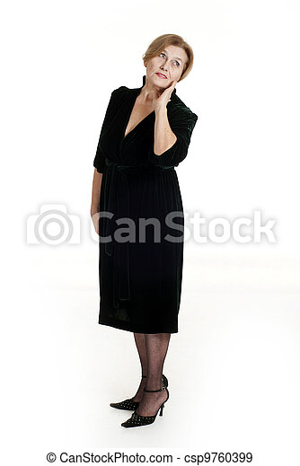old woman in black dress standing - csp9760399