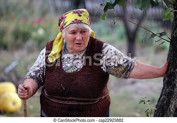 Old woman with a stick  - csp22923882