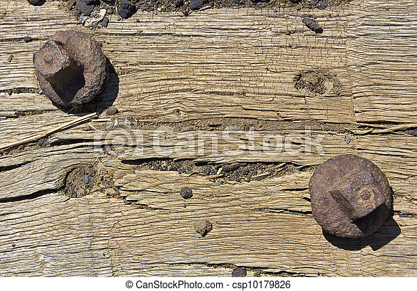 Old wood background with rusty screws, cracked - csp10179826
