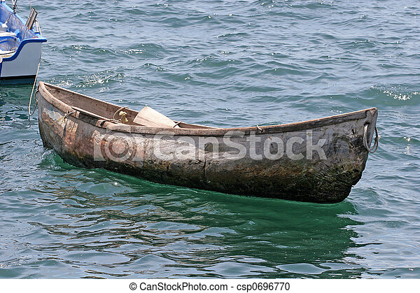 Old Wood Canoe An Wooden Afloat In The Bay Stock