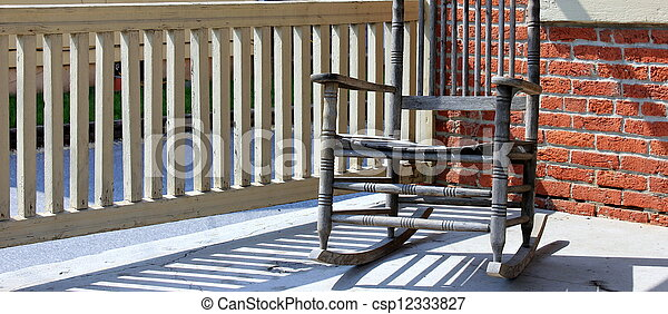 Old Wood Rocking Chair On Porch Stock Photo