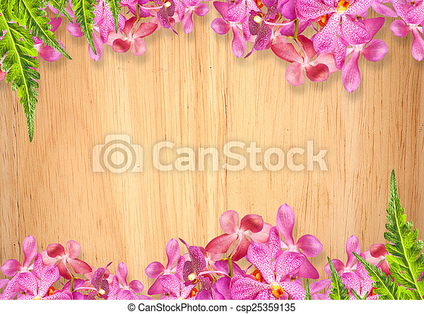 Old wooden background with pink orchid flowers frame.