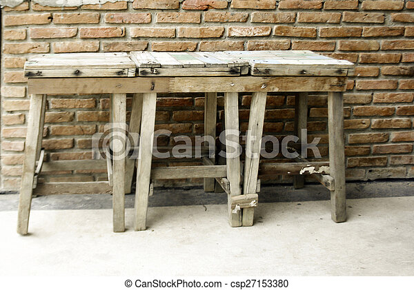 old wooden chairs on wall - csp27153380