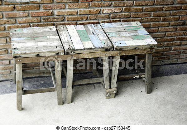 old wooden chairs on wall - csp27153445