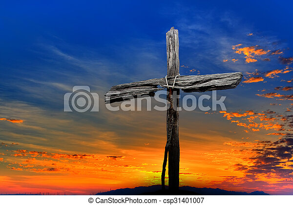 Old wooden cross over dramatic sunset - csp31401007