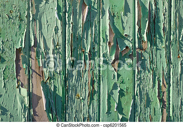 Old wooden fence flaky green paint close up. - csp6201565