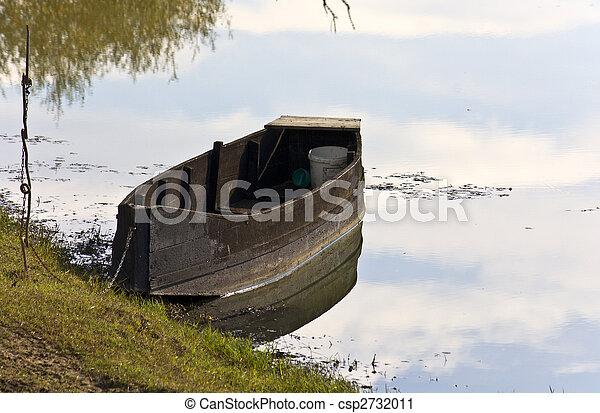 Old wooden fishing boat at lake Kerkini in Greece - csp2732011
