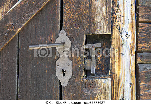 Old wooden outhouse lock - csp37773627 & Old wooden outhouse lock. Old wooden outhouse door lock details.
