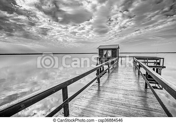Old Wooden Pier For Fishing, Small House Shed And Beautiful Lake - csp36884546