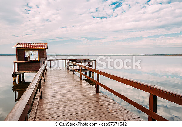 Old Wooden Pier For Fishing, Small House Or Shed And Beautiful L - csp37671542