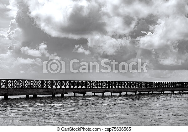 old wooden pier goes to sea - csp75636565