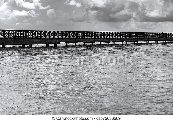 old wooden pier goes to sea - csp75636569