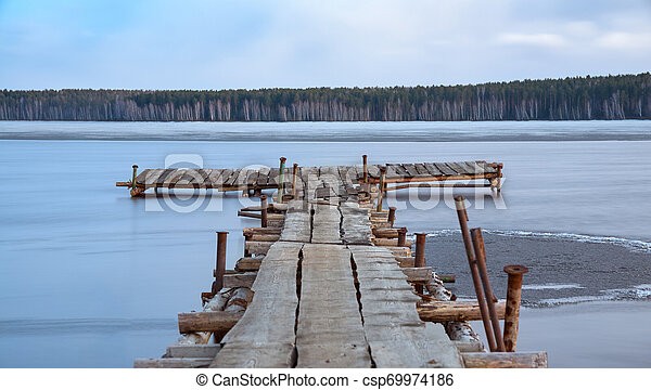 old wooden pier on the lake - csp69974186