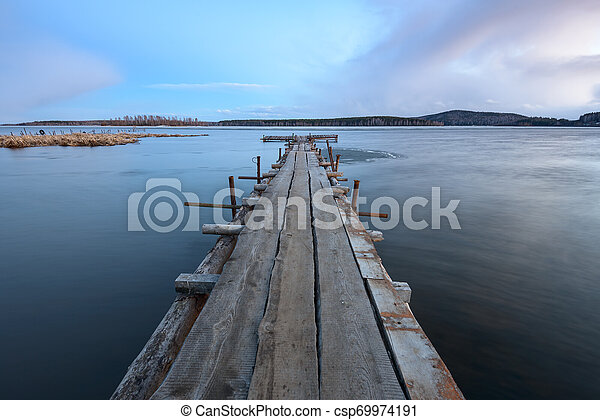 old wooden pier on the lake - csp69974191