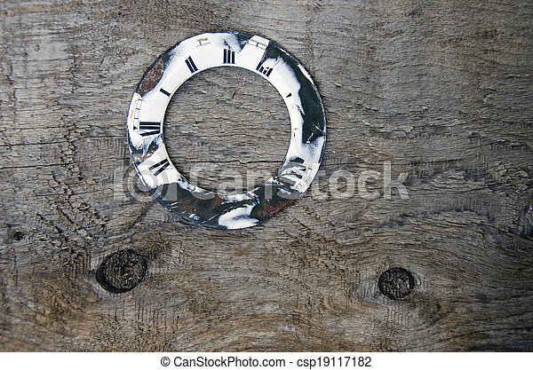 old wooden plank with clock dial background - csp19117182