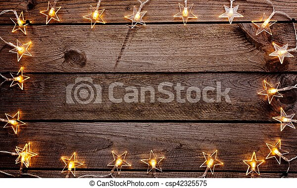 old wooden rustic christmas background with star shaped lights - Rustic Christmas Background