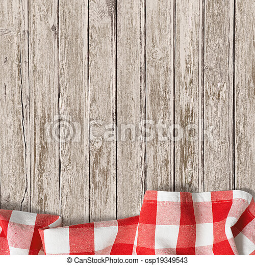 old wooden table with red picnic tablecloth background - csp19349543