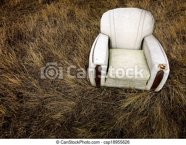 Old Worn Chair Abandoned In Grass Weeds