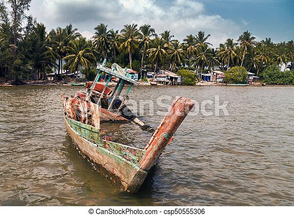 Old wrecked ship on the beach sea coast. - csp50555306