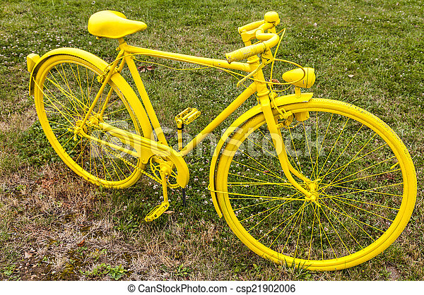 Old Yellow Bicycle in a Field - csp21902006