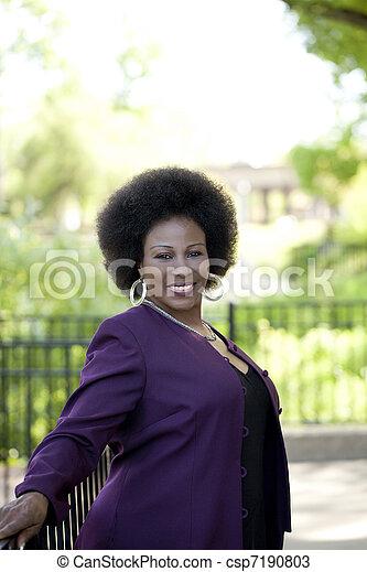 Older African American Woman Outdoor portrait purple - csp7190803
