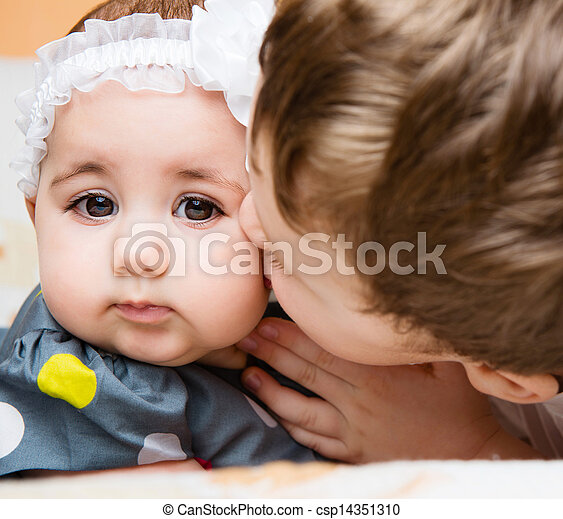 Older brother kissing his baby sister - csp14351310