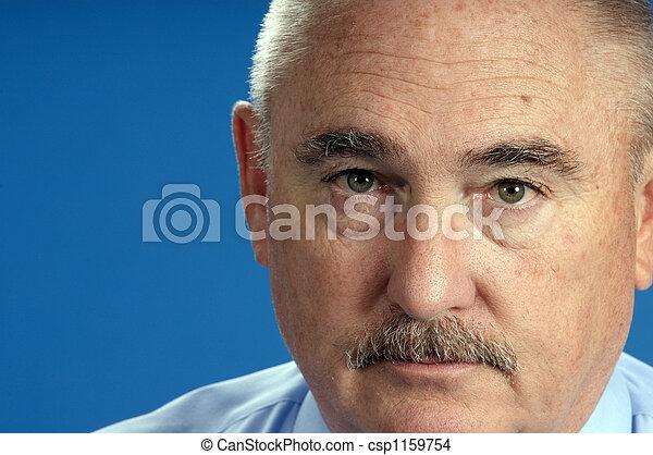 older businessman in close up - csp1159754
