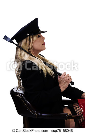 Older Caucasian Woman Sitting Profile In Chair With Riding Crop - csp75158048
