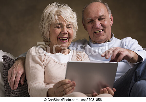 Older couple and new technology - csp37081856