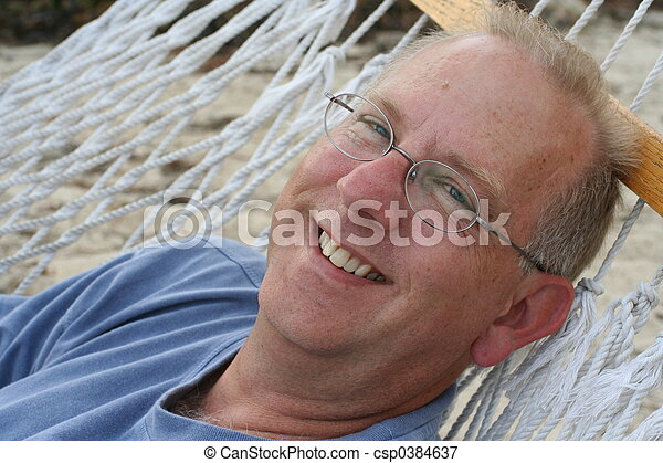 Older Man in Hammock - csp0384637