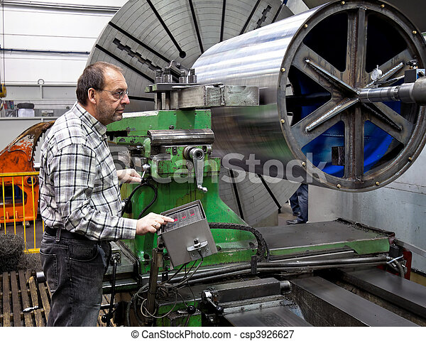 Older workers in the metal industry in CNC milling machine. - csp3926627